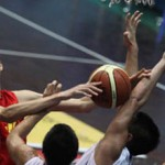 Qi Zhou fights for a rebound at the U16 Asia Championship - photo by Milad Payami/FIBAAsia.net