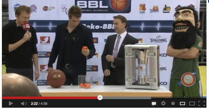 Richard Schmidt looks at one of the draw balls after rattling it and just before he places it back into the glass container and choosing another.