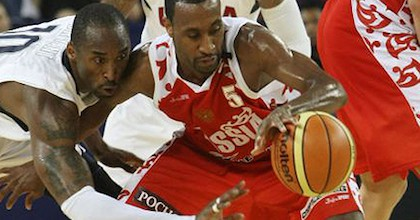 JR Holden battles Kobe Bryant for a ball at the 2008 Olympics. He didn't have nearly as tough a battle with David Hein in his interview for Taking The Charge. Photograph: Eugene Hoshiko/AP