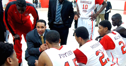 Larry Blunt talks to his Orangeville Prep team during the 2014-15 season.