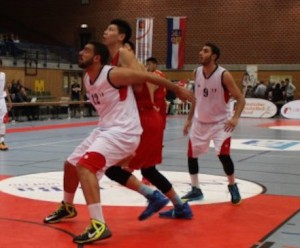 China center talent Zhu Rongzhen (red middle) was just too much for Egypt - Photo DBB